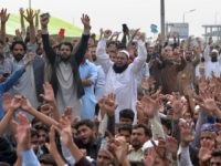 Supporters of the Tehreek-e-Labaik Pakistan (TLP), a hardline religious political party, chant slogans during a protest on the blocked Faizabad bridge following the Supreme Court decision to acquit Christian woman Asia Bibi, in Islamabad on November 1, 2018. - Pakistani Prime Minister Imran Khan hit out at religious hardliners and …