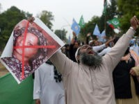 A Pakistani supporter of the Ahle Sunnat Wal Jamaat (ASWJ), a hardline religious party, holds an image of Christian woman Asia Bibi during a protest rally following the Supreme Court's decision to acquit Bibi of blasphemy, in Islamabad on November 2, 2018. - Pakistan's powerful military warned November 2 its …