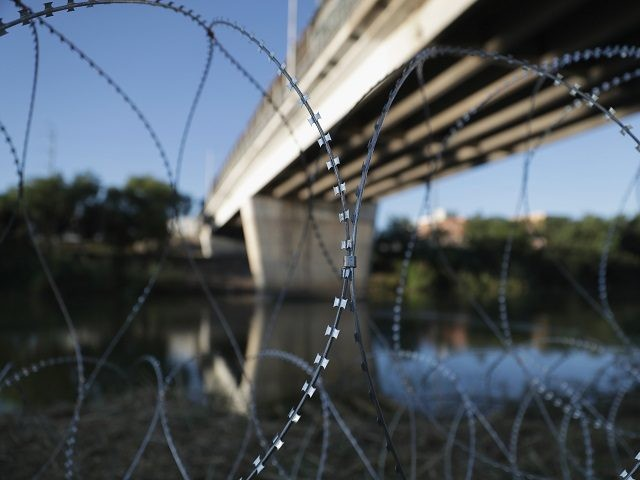 HIDALGO, TX - NOVEMBER 03: Protective wire stretches along the Rio Grande after being installed by U.S. Army troops at the U.S.-Mexico border on November 3, 2018 in Hidalgo, Texas. U.S. President Donald Trump ordered the troops to the border to bolster security at points of entry, especially at international …