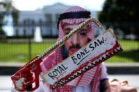 WASHINGTON, DC - OCTOBER 19: A protester dressed as Saudi Arabian crown prince Mohammad bin Salman, demonstrates with members of the group Code Pink outside the White House in the wake of the disappearance of Saudi Arabian journalist Jamal Khashoggi October 19, 2018 in Washington, DC. Khashoggi has disappeared following …