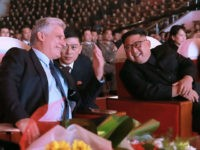 This photo taken on November 4, 2018 and released by North Korea's official Korean Central News Agency (KCNA) on November 5 shows North Korean leader Kim Jong Un (R) and Cuba's President Miguel Diaz-Canel (L) chatting while watching an art performance in Pyongyang. (Photo by KCNA VIA KNS / KCNA …