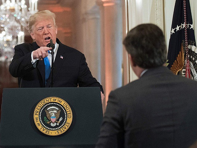 US President Donald Trump gets into a heated exchange with CNN chief White House correspondent Jim Acosta (R) during a post-election press conference in the East Room of the White House in Washington, DC on November 7, 2018. (Photo by Jim WATSON / AFP) (Photo credit should read JIM WATSON/AFP/Getty …
