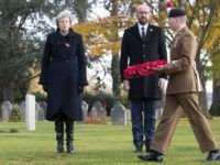 Britain's Prime Minister Theresa May (L) and Belgium's Prime Minister Charles Michel (2ndR) stand during the commemoration of the 100th anniversary of the end of the First World War at the Saint-Symphorien Military Cemetery, near Mons, on November 9, 2018. (Photo by BENOIT DOPPAGNE / Belga / AFP) / Belgium …