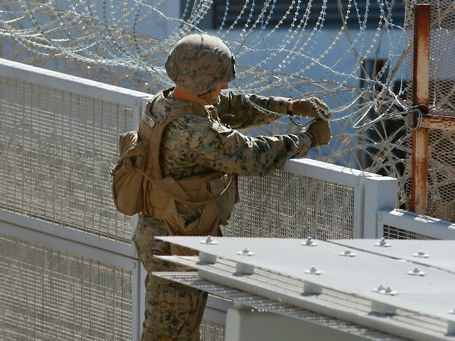 US marines place barbed wire atop fencing along the United States-Mexico border in San Ysidro, California, on November 9, 2018. (Photo by Sandy Huffaker / AFP) (Photo credit should read SANDY HUFFAKER/AFP/Getty Images)