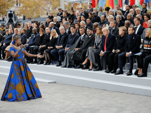 Beninese singer Angelique Kidjo performs in front of Heads of State and government attending a ceremony at the Arc de Triomphe in Paris on November 11, 2018 as part of commemorations marking the 100th anniversary of the 11 November 1918 armistice, ending World War I. (Photo by Francois Mori / …