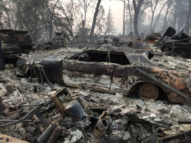 Jhonathan Clark's burned property is seen in Paradise, California, on November 15, 2018. - Jhonathan Clark was speechless, with his hands on his head he began to walk through the sea of rubble in which his house in Paradise became, a village massacred by fire. His great concern now is …