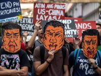 "People holds caricatures of China's President Xi Jinping during a protest in Manila on November 20, 2018. - Chinese President Xi Jinping called his visit on November 20 to long-time US ally the Philippines a ""milestone"", as he aimed to boost blossoming ties on the promise of billions of dollars …"