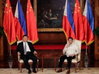 "Chinese President Xi Jinping (L) and Philippines' President Rodrigo Duterte (R) look on during an exchange of agreements at the Malacanang Presidential Palace in Manila on November 20, 2018. - Chinese President Xi Jinping called his visit on November 20 to long-time US ally the Philippines a ""milestone"", as he …"