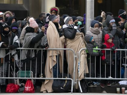 The crowd bundles up against the cold to watch the 92nd Annual Macy's Thanksgiving Day Parade on November 22, 2018, in New York. (Photo by Don EMMERT / AFP) (Photo credit should read DON EMMERT/AFP/Getty Images)