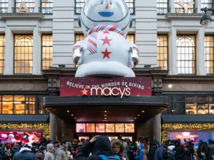 NEW YORK, NY - NOVEMBER 22: Customers wait in the cold outside the Herald Square Macy's Flag ship store for the early Black Friday sales on November 22, 2018 in New York City. Known as 'Black Friday', the day after Thanksgiving marks the beginning of the holiday shopping season, with …