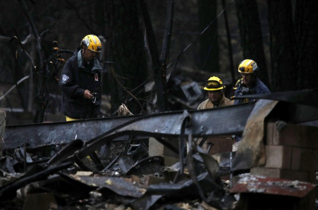 PARADISE, CA - NOVEMBER 22: Search and rescue crews search a property that was destroyed by the Camp Fire for human remains on November 22, 2018 in Paradise, California. Fueled by high winds and low humidity the Camp Fire ripped through the town of Paradise charring over 150,000 acres, killed …