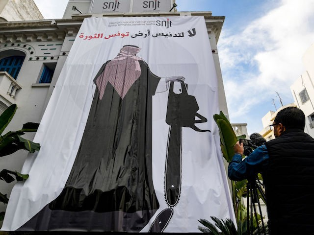 "This picture taken on November 26, 2018 shows a giant banner hanging at the headquarters of Tunisia's Journalists Union in the capital Tunis depicting a cartoon of Saudi Crown Prince Mohammed bin Salman holding a chainsaw with a caption above reading in Arabic ""no to the desecration of Tunisia, the …"