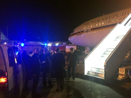 """People gather around German Chancellor's Airbus """"Konrad Adenauer"""" on November 29, 2018 on the tarmac of Cologne's airport after an emergency landing. - German Chancellor Angela Merkel will miss the opening of the G20 summit in Argentina after her plane was forced to make an emergency landing in Cologne due …"""