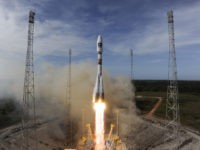 KOUROU, FRENCH GUIANA - OCTOBER 12: In this handout image supplied by the European Space Agency (ESA), the Soyuz rocket lifts off for the third time from Europe's Spaceport in French Guiana on its mission to place the second pair of Galileo In-Orbit Validation satellites into orbit, on October 12, …