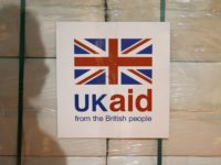 KEMBLE, UNITED KINGDOM - AUGUST 14: A UK aid label attached to a box containing kitchen sets, which are stored at a UK Aid Disaster Response Centre at Cotswold Airport on August 14, 2014, in Kemble, United Kingdom. The Prime Minister will hold a meeting with the COBRA emergency committee …
