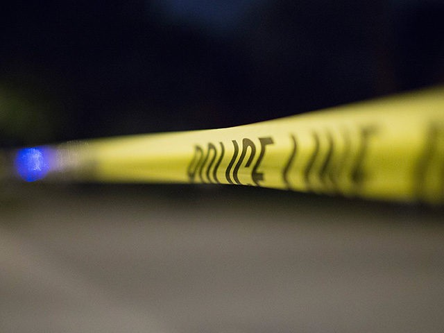 CHICAGO IL- SEPTEMBER 28 Crime scene tape secures a shooting scene where 5 people were reported to have been shot including an 11-month-old infant
