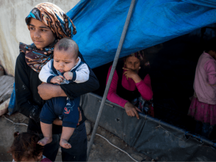 IZMIR, TURKEY - APRIL 28: Syrian refugee's are seen at a tent camp on the outskirts of Izmir on April 28, 2016 in Izmir, Turkey. For many Syrian refugees, living in Turkey has become their only option. With the new E.U.-Turkey deal effectively shutting down the route to Europe and …