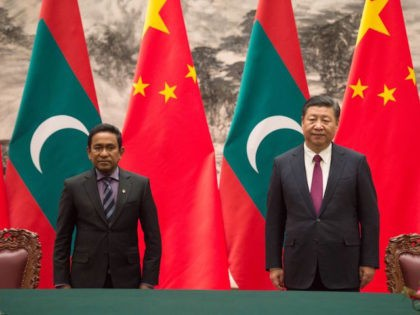 Maldives' President Abdulla Yameen (L) stands with China's President Xi Jinping during a signing ceremony at the Great Hall of the People in Beijing on December 7, 2017. / AFP PHOTO / POOL / Fred DUFOUR (Photo credit should read FRED DUFOUR/AFP/Getty Images)