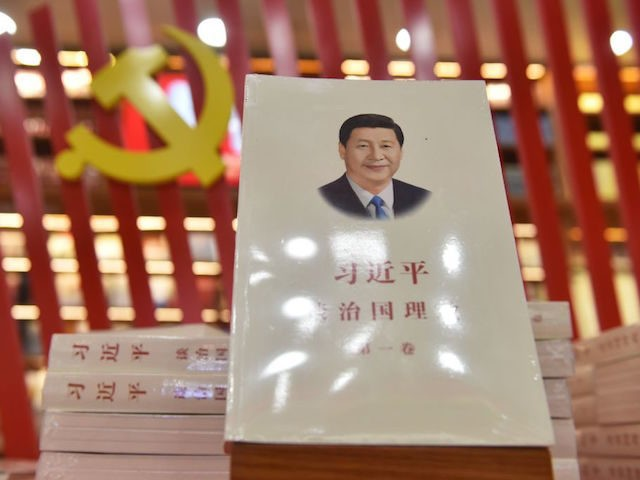 "A book about Chinese President Xi Jinping entitled ""The Governance of China"" is seen on display at a bookstore in Beijing on February 28, 2018. President Xi Jinping's leap toward lifelong rule has largely been met by guarded silence in world capitals as governments try to predict how China's formidable …"