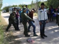 MCALLEN, TX - JUNE 12: U.S. Border Patrol agents take a group of Central American asylum seekers into custody on June 12, 2018 near McAllen, Texas. The immigrant families were then sent to a U.S. Customs and Border Protection (CBP) processing center for possible separation. U.S. border authorities are executing …