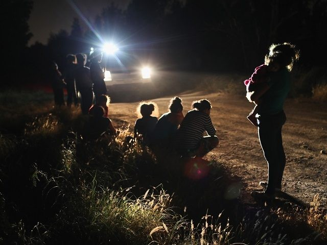MCALLEN, TX - JUNE 12: U.S. Border Patrol agents arrive to detain a group of Central American asylum seekers near the U.S.-Mexico border on June 12, 2018 in McAllen, Texas. The group of women and children had rafted across the Rio Grande from Mexico and were detained before being sent …