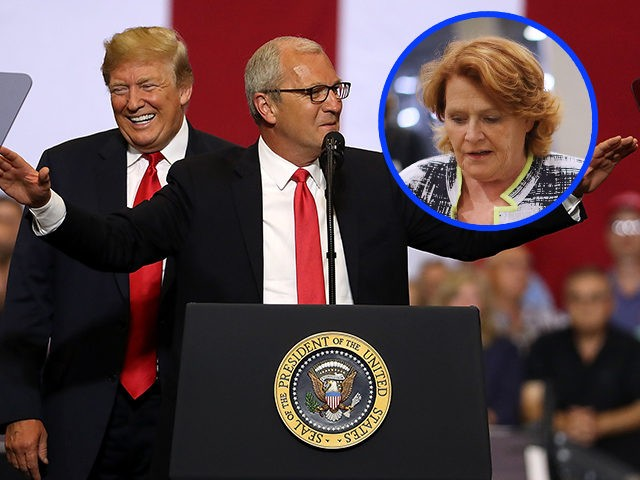 "FARGO, ND - JUNE 27: U.S. president Donald Trump (L) looks on as U.S. Rep. Kevin Cramer (R-ND) speaks to supporters during a campaign rally at Scheels Arena on June 27, 2018 in Fargo, North Dakota. President Trump held a campaign style ""Make America Great Again"" rally in Fargo, North …"
