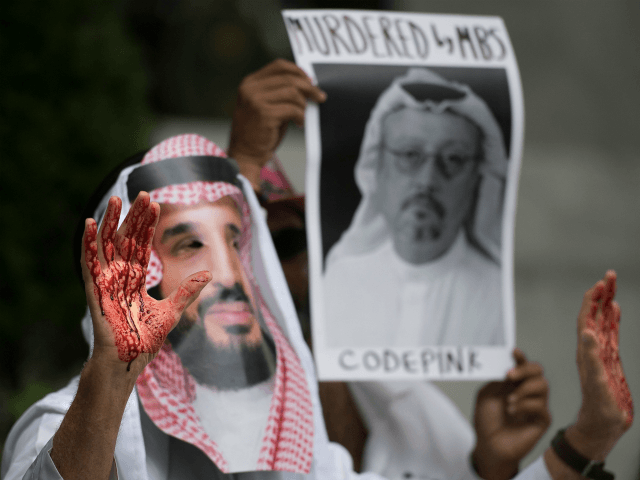 A demonstrator dressed as Saudi Arabian Crown Prince Mohammed bin Salman (C) with blood on his hands protests outside the Saudi Embassy in Washington, DC, on October 8, 2018, demanding justice for missing Saudi journalist Jamal Khashoggi. - US President Donald Trump said October 10, 2018 he has talked to …