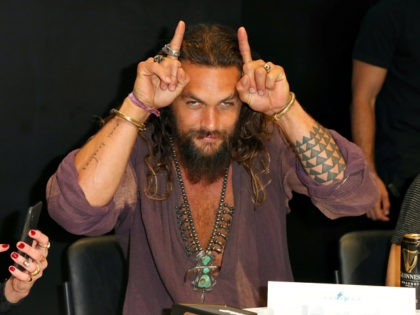 SAN DIEGO, CA - JULY 21: Jason Momoa attends DC Entertainment's Warner Bros. Pictures 'Aquaman' Autograph Signing during Comic-Con International 2018 at San Diego Convention Center on July 21, 2018 in San Diego, California. (Photo by Joe Scarnici/Getty Images)