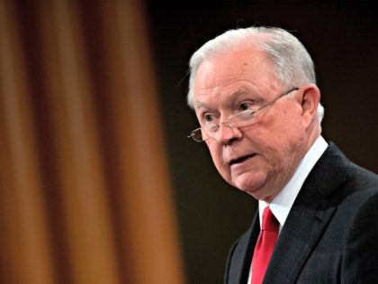 Attorney General Jeff Sessions announces the creation of a new initiative to crack down on Chinese intelligence officials pilfering intellectual property from US corporations through hacking and espionage during a press conference at the Justice Department in Washington, DC, on November 1, 2018. - US Attorney General Jeff Sessions announced …