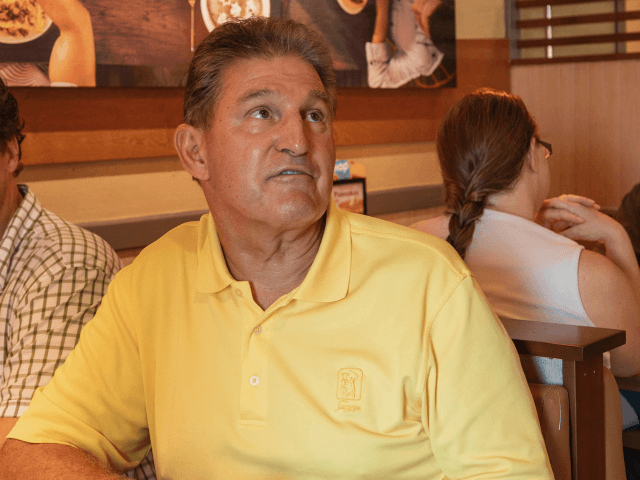 Senator Joe Manchin speaks to Michelle Cowley about her opinion on his recent vote in the Senate to confirm Brett Kavanaugh, Sunday, Oct. 7, 2018 at IHOP Charleston W.Va. A day after Manchin broke with his party on what may be the most consequential vote of the young Trump era, …