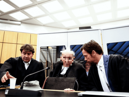 NOVEMBER 6: (EDITORS NOTE: Defendant's face pixeled by court order) Defendant Dr. Johann R. (C) with his lawyers attends a session of the trial against him at the Regional Court in Muenster, Germany, 06 November 2018. The 94-year-old accused and former SS guard Dr. Johann R. faces trial, charged with …