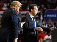 Republican Senate candidate Josh Hawley is guided to the podium to speak by President Donald Trump during a rally at Show Me Center, Monday, Nov. 5, 2018, in Cape Girardeau, Mo.. (AP Photo/Carolyn Kaster)
