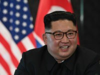 North Korea's leader Kim Jong Un reacts at a signing ceremony with US President Donald Trump (not pictured) during their historic US-North Korea summit, at the Capella Hotel on Sentosa island in Singapore on June 12, 2018. - Donald Trump and Kim Jong Un became on June 12 the first …