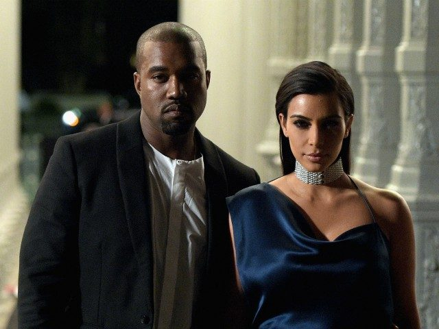 LOS ANGELES, CA - NOVEMBER 01: Recording artist Kanye West (L) and TV personality Kim Kardashian attend the 2014 LACMA Art + Film Gala honoring Barbara Kruger and Quentin Tarantino presented by Gucci at LACMA on November 1, 2014 in Los Angeles, California. (Photo by Jason Kempin/Getty Images for LACMA)