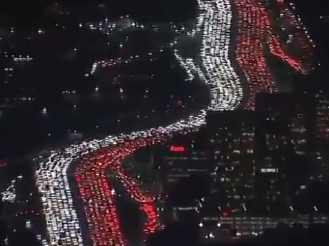 Footage shared to social media shows thousands of commuters sitting in gridlock traffic on Los Angeles's 405 Freeway ahead of Thanksgiving Day.