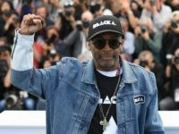 CANNES, FRANCE - MAY 15: Director Spike Lee holds up a fist as he attends the photocall for 'BlacKkKlansman' during the 71st annual Cannes Film Festival at Palais des Festivals on May 15, 2018 in Cannes, France. (Photo by Pascal Le Segretain/Getty Images)