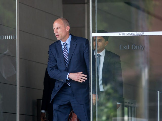 Attorney Michael Avenatti, who represents adult film actress Stormy Daniels, walks from the courthouse during a break in a motions hearing on July 27, 2018 in Los Angeles, California. Daniels, whose real name is Stephanie Clifford, is suing President Donald Trump and his former personal attorney, Michael Cohen, claiming that …