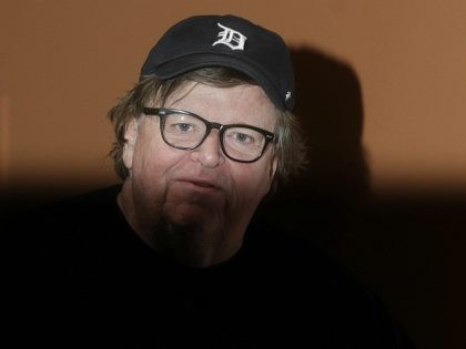"""Michael Moore poses for photographers during a photo call of the movie """"Fahrenheit 11/9"""" at the 13th edition of the Rome Film Fest, in Rome, Saturday, Oct. 20, 2018. (AP Photo/Gregorio Borgia)"""