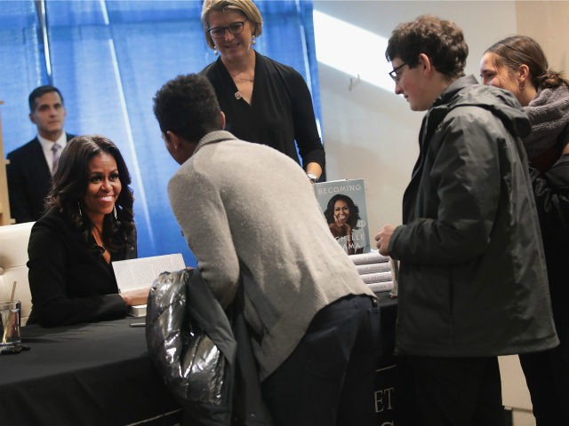 "Former first lady Michelle Obama kicks off her ""Becoming"" book tour with a signing at the Seminary Co-op bookstore on November 13, 2018 in Chicago, Illinois. In the book, which was released today, Obama describes her journey from Chicago's South Side to the White House. (Photo by Scott Olson/Getty Images)"