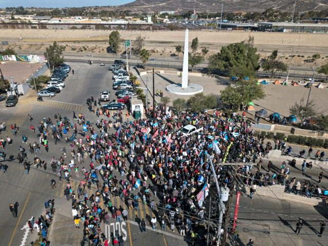 A group of migrants gather at the Chaparral border crossing in Tijuana, Mexico, Sunday, Nov. 25, 2018, as they try to pressure their way into the U.S. The mayor of Tijuana has declared a humanitarian crisis in his border city and says that he has asked the United Nations for …