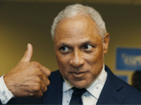 In this Friday, Sept. 7, 2018 photo, Mike Espy, a Democrat and former President Bill Clinton's first agriculture secretary, gives a thumbs up sign of approval at the Jackson, Miss., opening of his campaign headquarters, as to the direction of his campaign for November's special election to fill the unexpired …