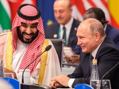 Russia's President Vladimir Putin (R) and Saudi Arabia's Crown Prince Mohammed bin Salman attend the G20 Leaders' Summit in Buenos Aires, on November 30, 2018. - Global leaders gather in the Argentine capital for a two-day G20 summit beginning on Friday likely to be dominated by simmering international tensions over …