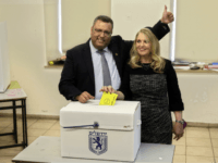 Mayoral candidate Moshe Lion, left, and his wife pose for the media as they cast their votes at a polling station in Jerusalem, Tuesday, Nov. 13, 2018. Israelis were choosing their next mayors in dozens of locations across the country Tuesday, with the main focus on the largest city of …