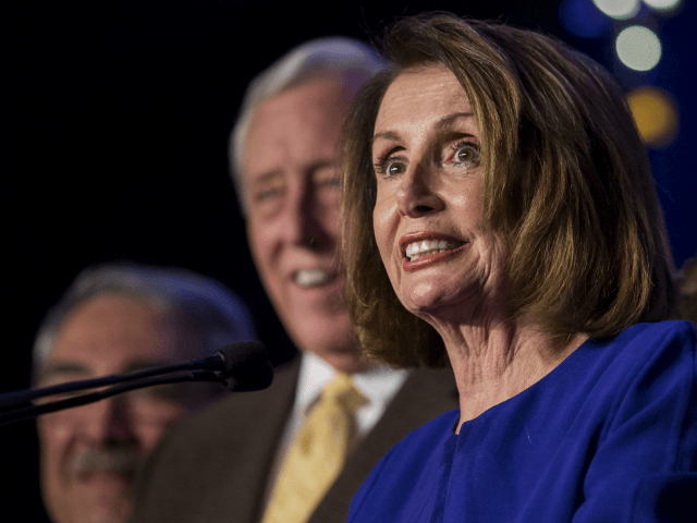 House Minority Leader Nancy Pelosi (D-CA), joined by House Democrats, delivers remarks during a DCCC election watch party at the Hyatt Regency on November 6, 2018 in Washington, DC. (Photo by Zach Gibson/Getty Images)