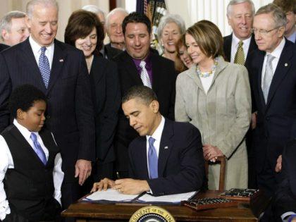 Obama Pelosi Obamacare AP