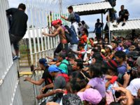 Migrants Push Through Guatemala Border