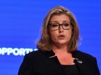 Britain's International Development Secretary and Minister for Women and Equalities Penny Mordaunt gives a speech in the main hall on the first day of the Conservative Party Conference 2018 at the International Convention Centre in Birmingham, on September 30, 2018. (Photo by Ben STANSALL / AFP) (Photo credit should read …