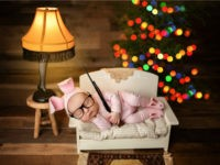 "A photographer is defending the inclusion of a BB replica in a baby's photo shoot that was inspired by ""A Christmas Story."""