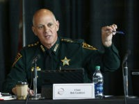 FILE- In this June 7, 2018 file photo Marjory Stoneman Douglas High School Public Safety Commission chair and Pinellas County Sheriff Bob Gualtieri gestures as he speaks during a commission meeting in Sunrise, Fla. Guiltieri says he now believes trained, volunteer teachers should have access to guns so they can …
