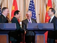 From left, Secretary of State Mike Pompeo, Chinese State Councilor and Defense Minister General Wei Fenghe, Secretary of Defense Jim Mattis, and Chinese Politburo Member Yang Jiechi shake hands at the conclusion of a news conference at the State Department in Washington, Friday, Nov. 9, 2018.